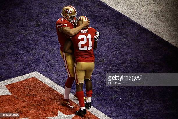 Colin Kaepernick and Frank Gore of the San Francisco 49ers celebrate after Gore scored a 6-yard rushing touchdown in the third quarter against the...