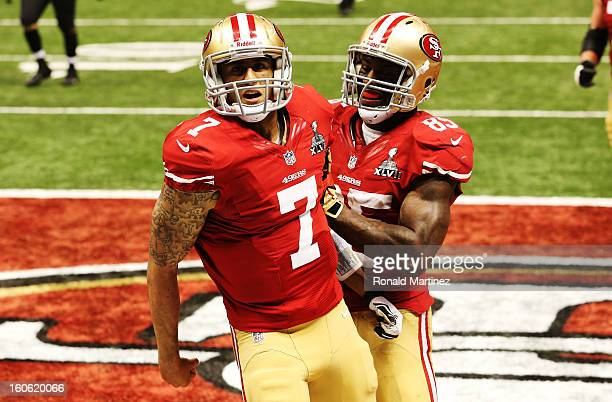 Colin Kaepernick and Vernon Davis of the San Francisco 49ers celebrate after Kaepernick scored a 15yard rushing touchdown in the fourth quarter...