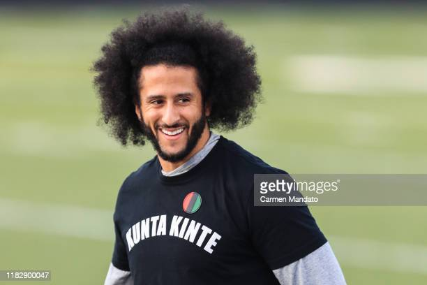 Colin Kaepernick looks on during a private NFL workout held at Charles R Drew high school on November 16, 2019 in Riverdale, Georgia. Due to...