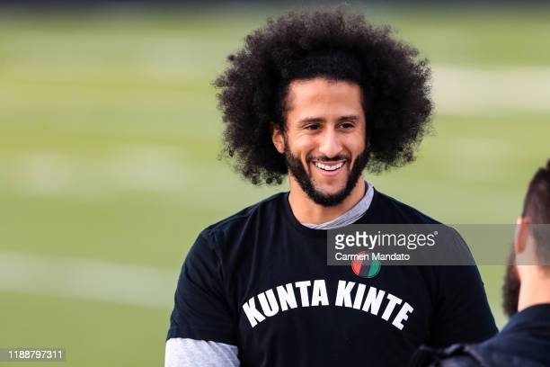 Colin Kaepernick looks on during his NFL workout held at Charles R Drew high school on November 16, 2019 in Riverdale, Georgia.