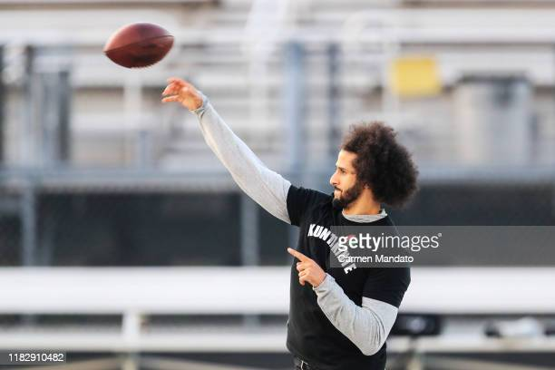 Colin Kaepernick looks to make a pass during a private NFL workout held at Charles R Drew high school on November 16, 2019 in Riverdale, Georgia. Due...