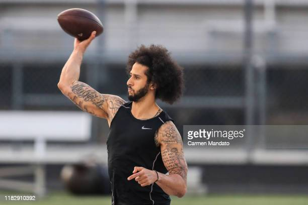 Colin Kaepernick makes a pass during a private NFL workout held at Charles R Drew high school on November 16, 2019 in Riverdale, Georgia. Due to...