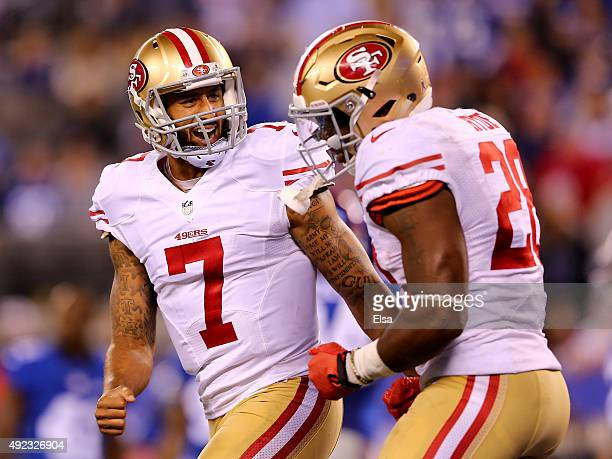 Colin Kaepernick of the San Francisco 49ers and Carlos Hyde celebrate Hyde's touchdown in the fourth quarter against the New York Giants at MetLife...