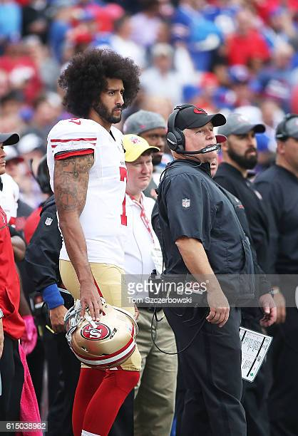 Colin Kaepernick of the San Francisco 49ers and head coach Chip Kelly of the San Francisco 49ers look on from the sideline during the first half...
