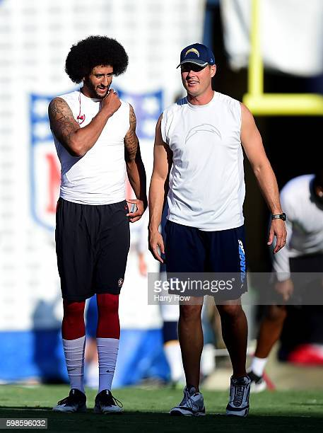 Colin Kaepernick of the San Francisco 49ers and Philip Rivers of the San Diego Chargers talk on the field before a preseason game at Qualcomm Stadium...
