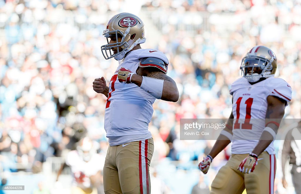 Colin Kaepernick #7 of the San Francisco 49ers celebrates after a touchdown in the third quarter against the Carolina Panthers during the NFC Divisional Playoff Game at Bank of America Stadium on January 12, 2014 in Charlotte, North Carolina.