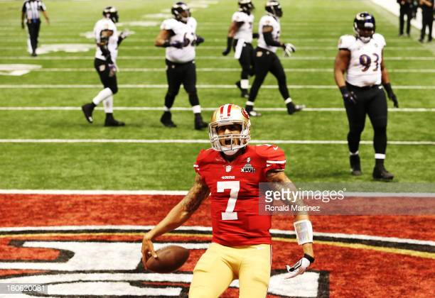 Colin Kaepernick of the San Francisco 49ers celebrates after he scored a 15-yard rushing touchdown in the fourth quarter against the Baltimore Ravens...