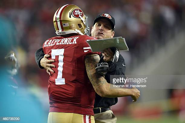 Colin Kaepernick of the San Francisco 49ers celebrates with head coach Jim Harbaugh after a 90 yard touchdown in the third quarter against the San...