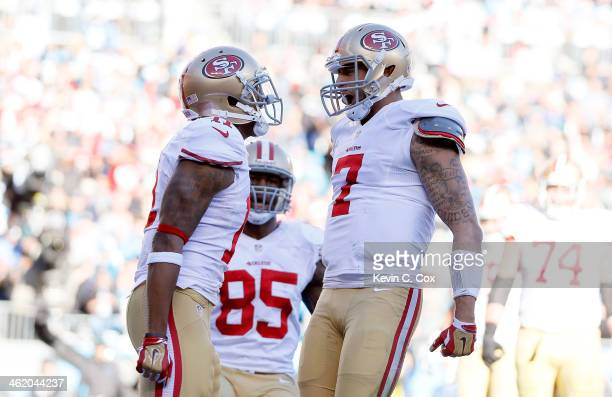 Colin Kaepernick of the San Francisco 49ers celebrates with Quinton Patton after a touchdown in the third quarter against the Carolina Panthers...