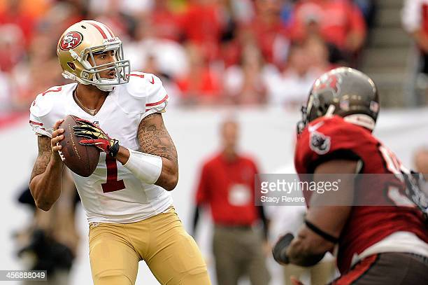 Colin Kaepernick of the San Francisco 49ers drops back to pass against the Tampa Bay Buccaneers during a game at Raymond James Stadium on December 15...