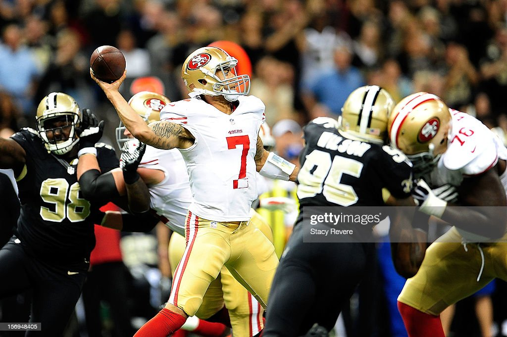 Colin Kaepernick #7 of the San Francisco 49ers drops back to pass while under pressure during a game against the New Orleans Saints at the Mercedes-Benz Superdome on November 25, 2012 in New Orleans, Louisiana.