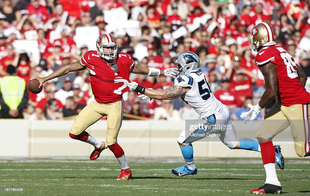99183c5e466 Colin Kaepernick of the San Francisco 49ers eludes A.J. Klein of the ...