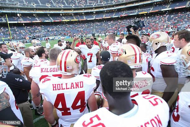 Colin Kaepernick of the San Francisco 49ers fires the team up prior to the game against the San Diego Chargers at Qualcomm Stadium on August 29 2013...