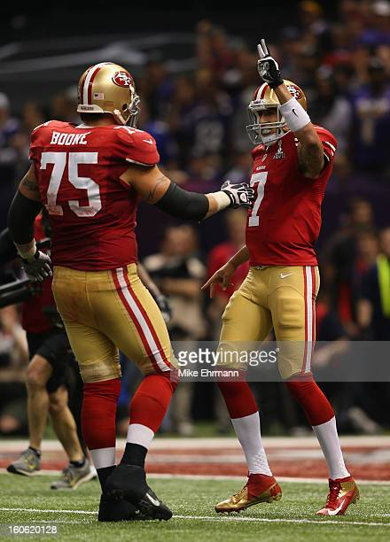 Colin Kaepernick of the San Francisco 49ers gestures to go for a twopoint conversion after scoring a rushing touchdown in the second half against the...