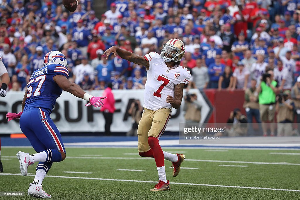 Colin Kaepernick #7 of the San Francisco 49ers gets rid of the ball before being sacked by Lorenzo Alexander #57 of the Buffalo Bills during the second half at New Era Field on October 16, 2016 in Buffalo, New York.