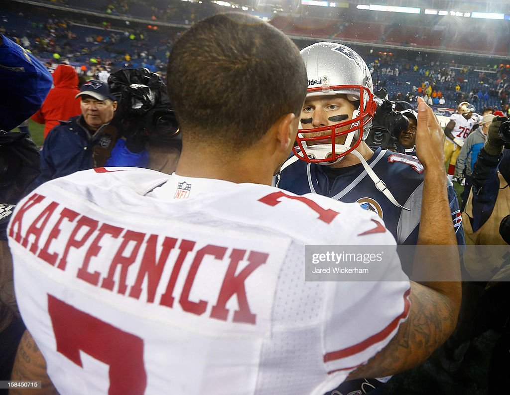 Colin Kaepernick #7 of the San Francisco 49ers greets Tom Brady #12 of the New England Patriots following their game at Gillette Stadium on December 17, 2012 in Foxboro, Massachusetts.