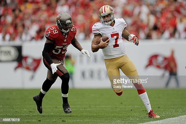 Colin Kaepernick of the San Francisco 49ers is pursued by Mason Foster of the Tampa Bay Buccaneers during a game at Raymond James Stadium on December...