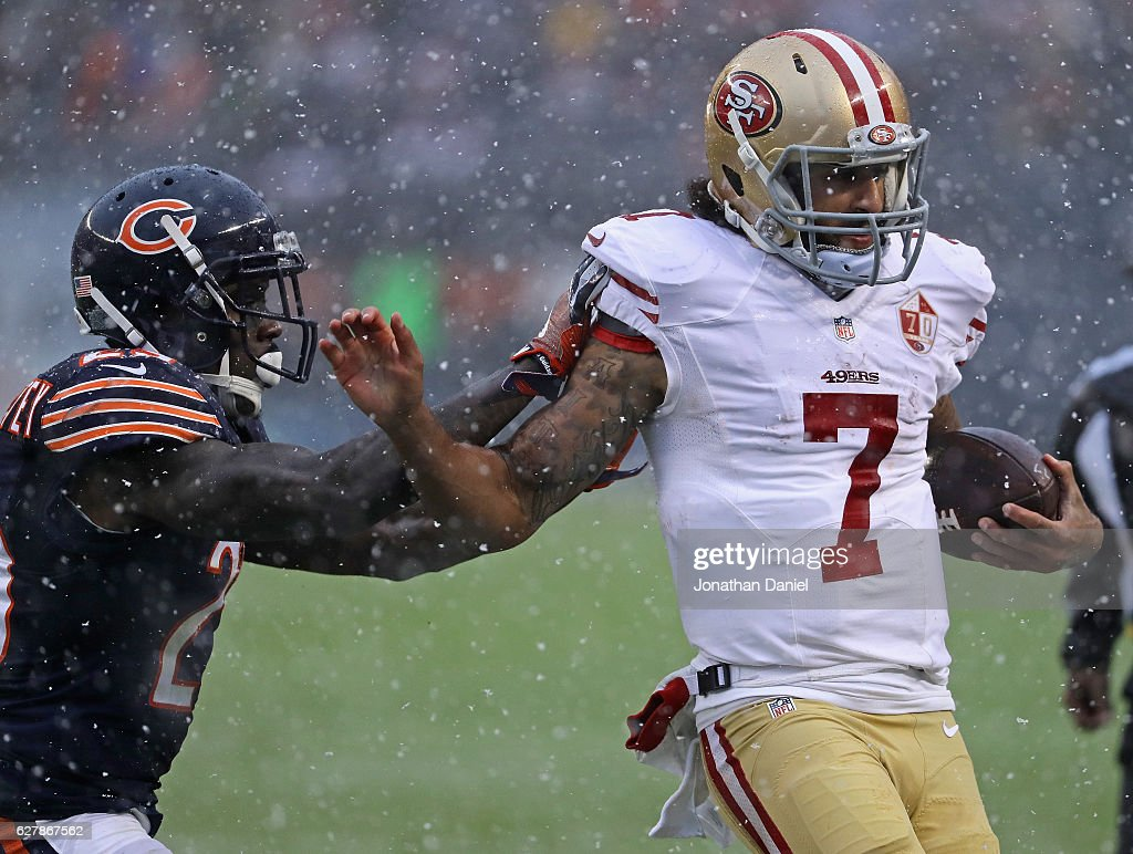 Colin Kaepernick #7 of the San Francisco 49ers is shoved out of bounds by Harold Jones-Quartey #29 of the Chicago Bears at Soldier Field on December 4, 2016 in Chicago, Illinois. The Bears defeated the 49ers 26-6.