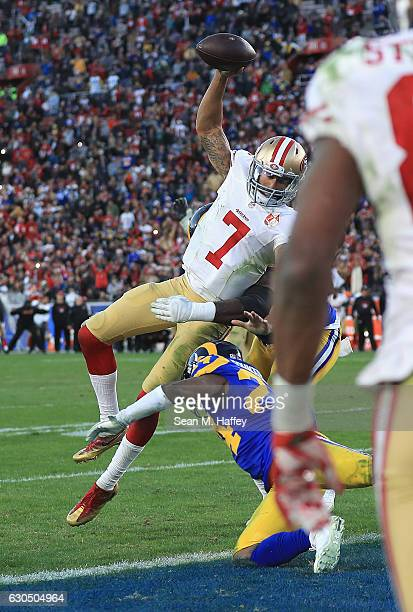 Colin Kaepernick of the San Francisco 49ers jumps into the end zone for a two point conversion during the fourth quarter against the Los Angeles Rams...