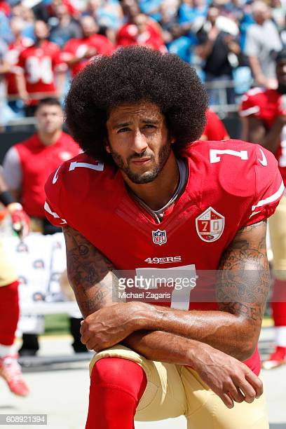 Colin Kaepernick of the San Francisco 49ers kneels during the anthem prior to the game against the Carolina Panthers at Bank of America Stadium on...
