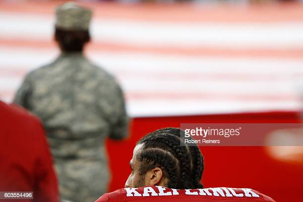 Colin Kaepernick of the San Francisco 49ers kneels in protest during the national anthem prior to playing the Los Angeles Rams in their NFL game at...