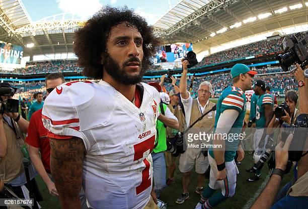 Colin Kaepernick of the San Francisco 49ers looks on during a game against the Miami Dolphins on November 27, 2016 in Miami Gardens, Florida.