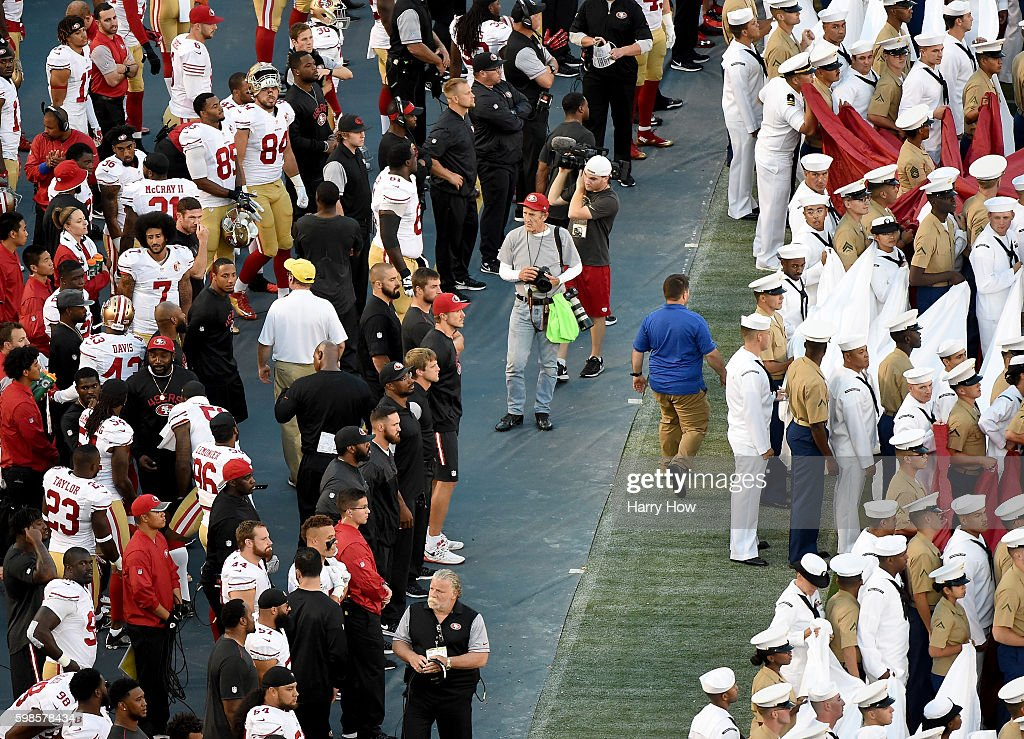 Colin Kaepernick #7 of the San Francisco 49ers on the sidelines as military personel line up before the singing of the National Anthem before a preseason game against the San Diego Chargers at Qualcomm Stadium on September 1, 2016 in San Diego, California.