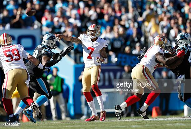 Colin Kaepernick of the San Francisco 49ers passes as Jonathan Goodwin and Frank Gore block during the game against the Carolina Panthers at Bank of...