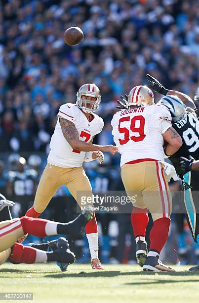Colin Kaepernick of the San Francisco 49ers passes as Jonathan Goodwin blocks during the game against the Carolina Panthers at Bank of America...