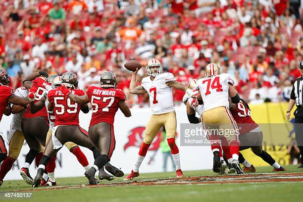 Colin Kaepernick of the San Francisco 49ers passes during the game against the Tampa Bay Buccaneers at Raymond James Stadium on December 15 2013 in...