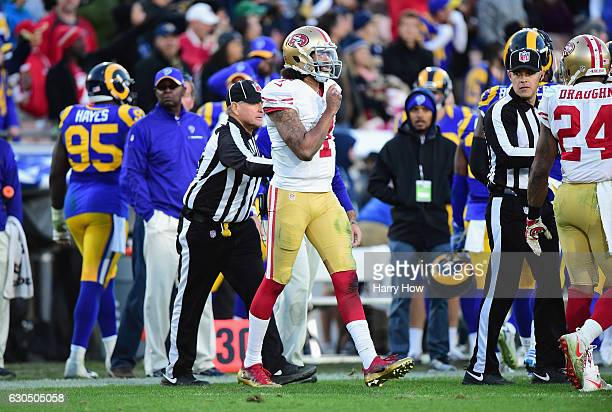 Colin Kaepernick of the San Francisco 49ers reacts after scoring a two point conversion during the fourth quarter against the Los Angeles Rams at Los...