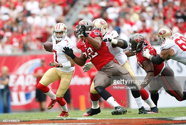 Colin Kaepernick of the San Francisco 49ers rushes for a 17yard gain during the game against the Tampa Bay Buccaneers at Raymond James Stadium on...