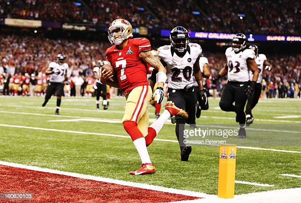 Colin Kaepernick of the San Francisco 49ers scores a 15yard rushing touchdown in the fourth quarter against Ed Reed of the Baltimore Ravens during...