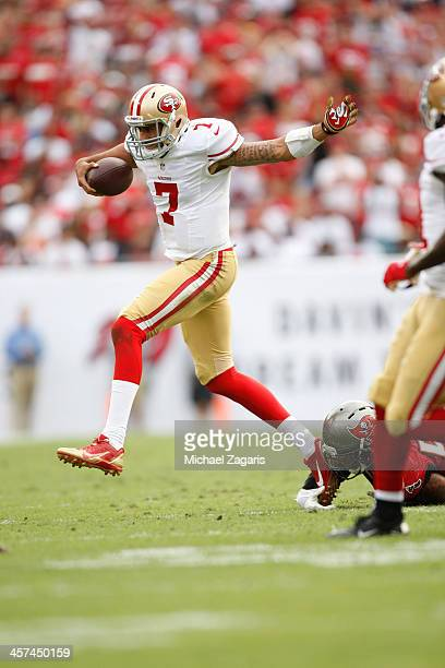 Colin Kaepernick of the San Francisco 49ers scrambles during the game against the Tampa Bay Buccaneers at Raymond James Stadium on December 15 2013...