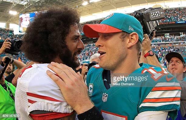 Colin Kaepernick of the San Francisco 49ers shakes hands with Ryan Tannehill of the Miami Dolphins during a game on November 27 2016 in Miami Gardens...