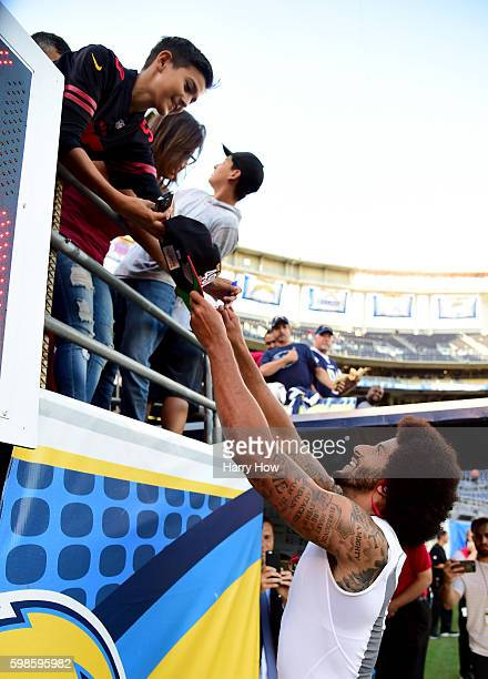 Colin Kaepernick of the San Francisco 49ers signs autographs before a preseason game against the San Diego Chargers at Qualcomm Stadium on September...