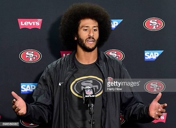 Colin Kaepernick of the San Francisco 49ers speaks to media during a press conference after a 3121 preseason win over the San Diego Chargers at...