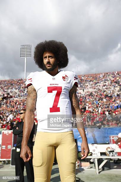 Colin Kaepernick of the San Francisco 49ers stands on the sideline prior to the game against the Los Angeles Rams at the Los Angeles Coliseum on...