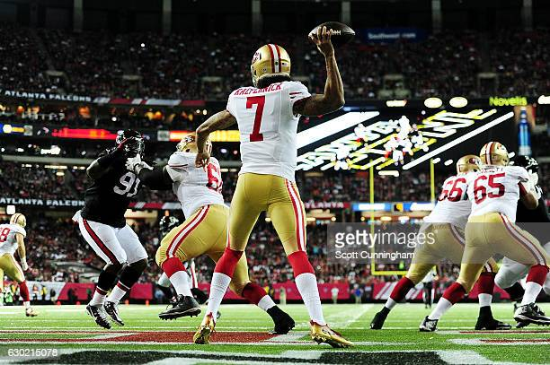 Colin Kaepernick of the San Francisco 49ers throws a pass during the first half against the Atlanta Falcons at the Georgia Dome on December 18 2016...