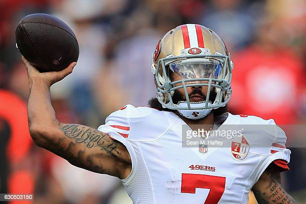 Colin Kaepernick of the San Francisco 49ers throws a pass during the first half against the Los Angeles Rams at Los Angeles Memorial Coliseum on...