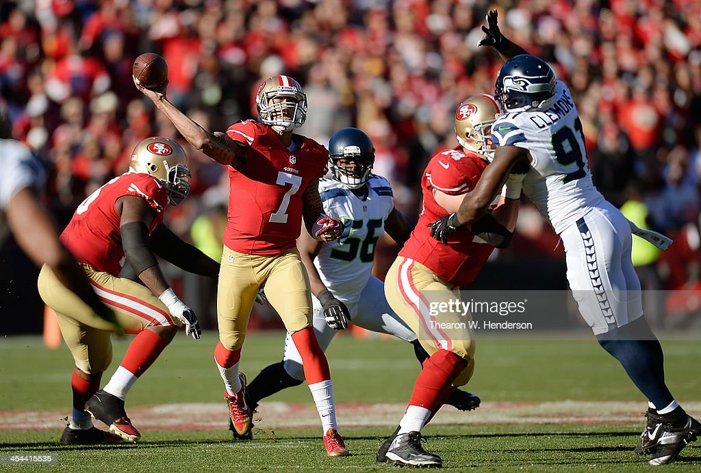 Colin Kaepernick #7 of the San Francisco 49ers throws a pass over the out stretched arm of Chris Clemons #91 of the Seattle Seahawks during the first quarter at Candlestick Park on December 8, 2013 in San Francisco, California.