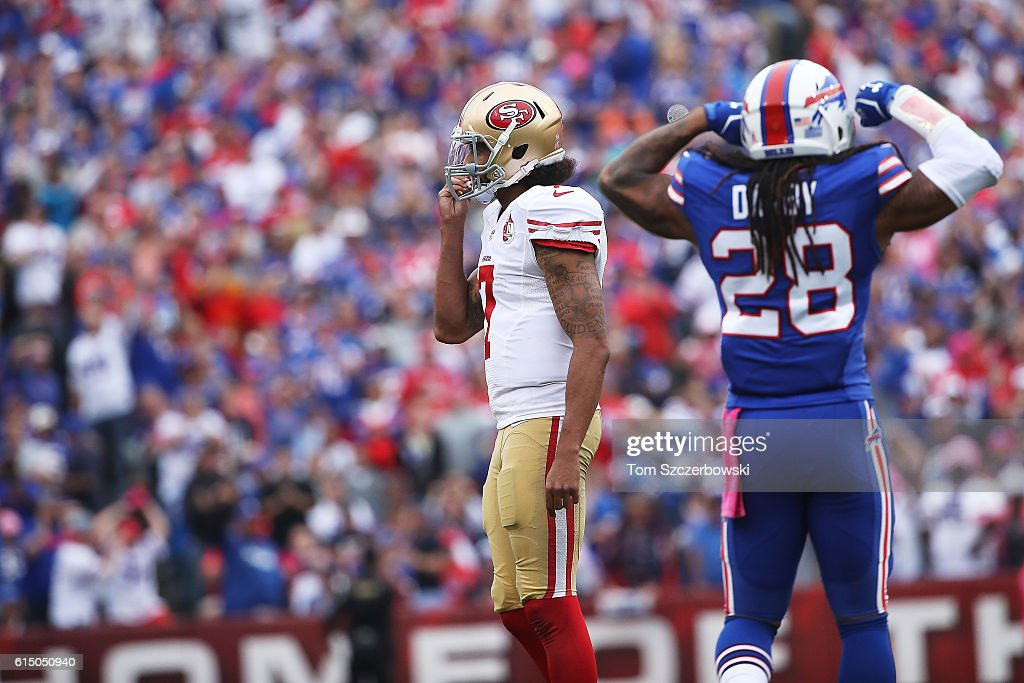 Colin Kaepernick #7 of the San Francisco 49ers turns it over on downs as Ronald Darby #28 of the Buffalo Bills celebrates during the second half at New Era Field on October 16, 2016 in Buffalo, New York.