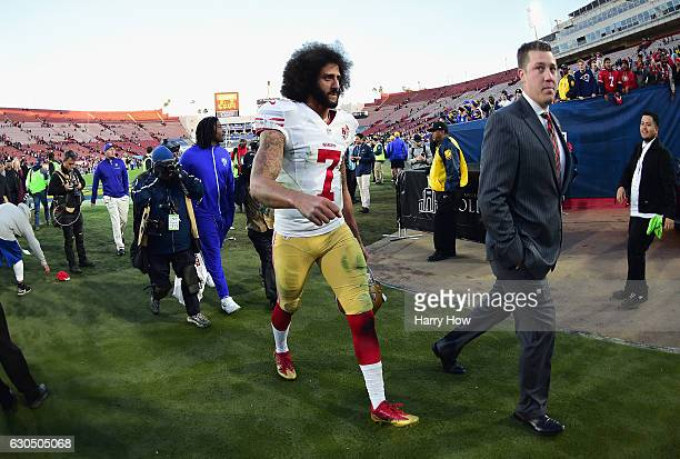 Colin Kaepernick of the San Francisco 49ers walks off the field after defeating the Los Angeles Rams 2221 at Los Angeles Memorial Coliseum on...