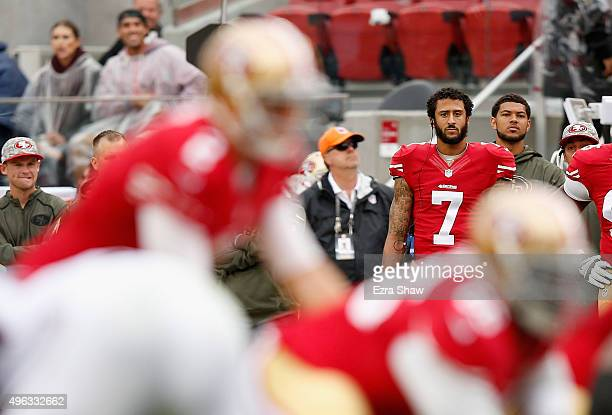 Colin Kaepernick of the San Francisco 49ers watches Blaine Gabbert play quarterback during their game against the Atlanta Falcons at Levi's Stadium...