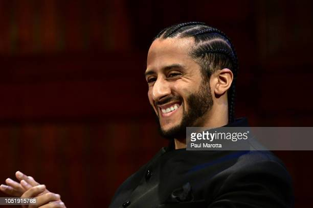 Colin Kaepernick on stage at the W.E.B. Du Bois Medal Award Ceremony at Harvard University on October 11, 2018 in Cambridge, Massachusetts. 2018...