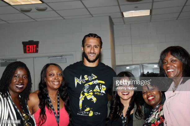 Colin Kaepernick poses with guests at Summer Jam 2018 at MetLife Stadium on June 10 2018 in East Rutherford New Jersey