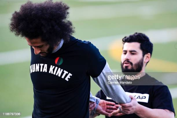 Colin Kaepernick stretches during his NFL workout held at Charles R Drew high school on November 16, 2019 in Riverdale, Georgia.