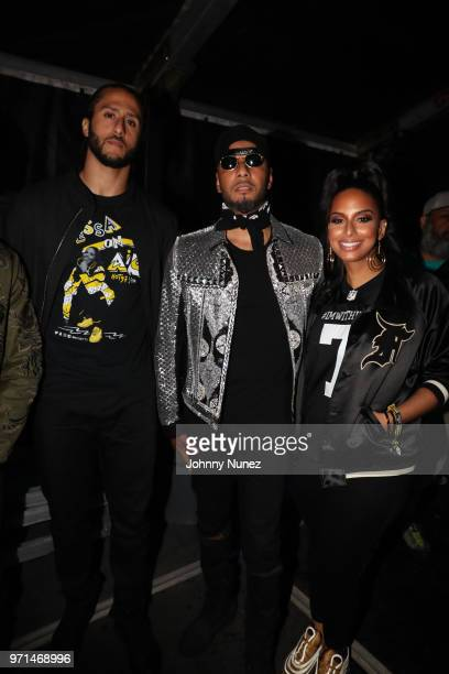 Colin Kaepernick Swizz Beatz and Nessa attend Summer Jam 2018 at MetLife Stadium on June 10 2018 in East Rutherford New Jersey