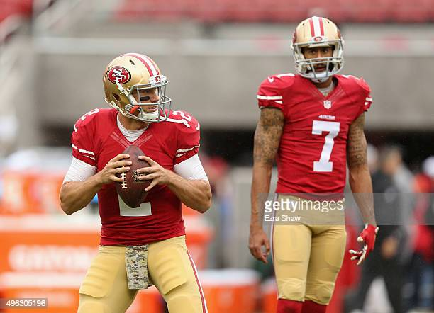 Colin Kaepernick watches Blaine Gabbert of the San Francisco 49ers warm up before their game against the Atlanta Falcons at Levi's Stadium on...