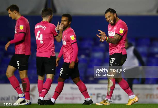 Colin Kazim-Richards of Derby County celebrates with teammate Graeme Shinnie after scoring their team's third goal during the Sky Bet Championship...